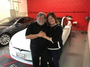 Steve Wozniak in front of his gifted Tesla