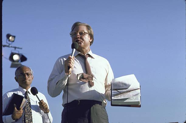 TV evangelist Jimmy Swaggart holding huge crowd spellbound, preaching at Flora Blanca Stadium.